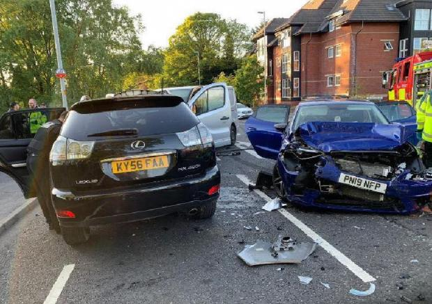 This Is Lancashire: All three cars were badly damaged