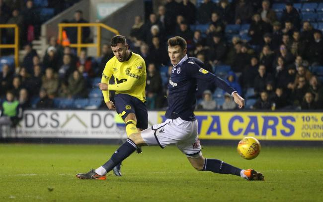 Adam Armstrong curls home his  goal at Millwall in January